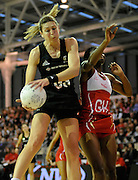 Irene Van Dyk grabs the ball, during New World Netball Series, New Zealand Silver Ferns v England at The ILT Velodrome, Invercargill, New Zealand. Thursday 6 October 2011 . Photo: Richard Hood photosport.co.nz