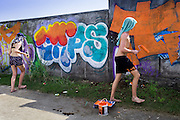 Touching up murals in Canggu.