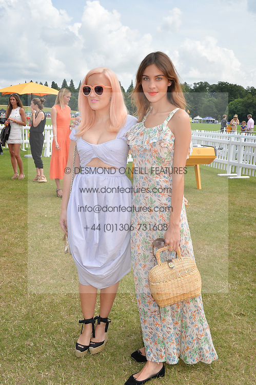 Left to right, LIZ MATTHEWS and ALEXA CHUNG at the Veuve Clicquot Gold Cup Final at Cowdray Park Polo Club, Midhurst, West Sussex on 20th July 2014.