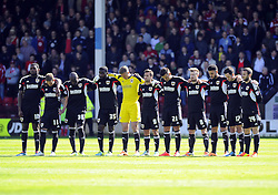 Bristol City players observe a minutes silence - Photo mandatory by-line: Joe Meredith/JMP - Mobile: 07966 386802 12/04/2014 - SPORT - FOOTBALL - Walsall - Banks' Stadium - Walsall v Bristol City - Sky Bet League One