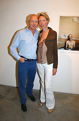 SIMON BREWER and REBECCA STEELS at a private view of 'The Living is Easy' an exhibition of contemporary photography held at Flowers East, 82 Kingsland Road, London E2 on 10th August 2006.<br /><br />NON EXCLUSIVE - WORLD RIGHTS