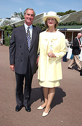 BARONESS JAY and her husband PROF.MICHAEL ADLER at the King George VI and The Queen Elizabeth Diamond Stakes sponsored by De Beers for the 33rd year held at Ascot Racecourse, Berkshire on July 24th 2004.
