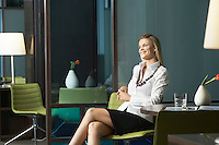 Businesswoman sitting in office smiling portrait