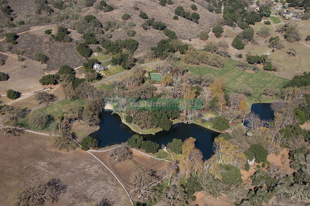 "EXCLUSIVE: Michael Jackson's former Neverland ranch is still yet to find a buyer almost three years after it went on the market to much fanfare with a $100million price tag. Photos taken January 2018 show the estate looking deserted, and while minimal upkeep has kept the famous floral clock intact, much of the surrounding grounds look sun-scorched and barren. The sprawling 3,000-acre property located near Santa Barbara, California, underwent extensive restoration efforts in 2013 in a bid to bring it back to it to its former glory. Jackson's children were involved in that effort, adding new features including a zen garden to replace the bustling fairground that once was, plus a 'boy in the moon' feature in one area of the grounds in homage to their late father's favorite fairytale character Peter Pan, who inspired the ranch's name. The estate was rebranded as Sycamore Valley Ranch when it was put up for sale in May 2015 with a $100million asking price. After no buyers were found, the price was reduced to $67 million in March 2017, but still nobody has come forward to buy it. In addition to a 12,500 sq ft main residence and a 3,700 sq ft pool house, the listing boasted a separate building with a 50-seat movie theater and a dance studio. Other features that remained included Jackson's ""Disney-style"" train station (minus the train), a fire house and a barn. Jackson, who died in 2009 from an overdose, bought the property for $30 million in 1988 and lived in it until the estate was raided by police as part of his 2005 child molestation trial, in which he was eventually acquitted on all charges. After the star quit the ranch, the estate went on a downward spiral and fell into disrepair. In 2008, a year before Jackson's death, the attractions from the centerpiece amusement park located on the grounds were removed and trucked down the highway. Jackson acquired around 18 fairground rides during his years at Neverland and since 2009 some now feature at the Cali"