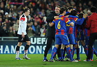 Football - Champions League - FC Basel vs. Manchester United<br /> Phil Jones of Manchester United looks dejected as his team are knocked out by a jubilant Basel team at St. Jakob Park, Basel