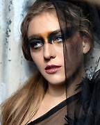 Closeup of beautiful fashion model Brenna Smith in a couture gown by Nick Nguyen of Mysterious by NPN for a shoot at the site of When World's Collide production of Industrial Evolution fashion show. By Gerard Harrison, Image Theory Photoworks.