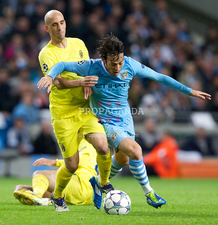 MANCHESTER, ENGLAND - Tuesday, Octover 18, 2011: Manchester City's David Silva in action against Villarreal CF's Borja Valero during the UEFA Champions League Group A match at the City of Manchester Stadium. (Pic by Vegard Grott/Propaganda)