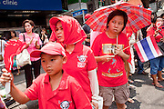 Apr. 12, 2010 - BANGKOK, THAILAND: Red Shirt supporters show respect for the bodies of Red Shirts killed in violent street battles Saturday. The funeral cortege for the Red Shirts killed in the violent crackdown Saturday wound through Bangkok Monday. Thousands of mourners came out to pay respects for dead Red Shirts. 21 people, including 16 Thai civilians were killed when soldiers tried to clear the Red Shirts' encampment in Bangkok. Thousands more came out to call for the government of Thai Prime Minister Abhisit Vejjajiva to step down. Today Gen. Anupong Paojinda, the Chief of Staff of the Thai Army, reiterated that the Army would not use violence to break up the protests and joined the call for the Prime Minister to call new elections. This is the beginning of Songkran, Thai New Year's week, and the government has cancelled the official festivities fearing more violence. It was during last year's Songkan festivities that the Thai Army and police used force to break up the Red Shirt protests. That protest is now called the Songkran Riots.     Photo By Jack Kurtz