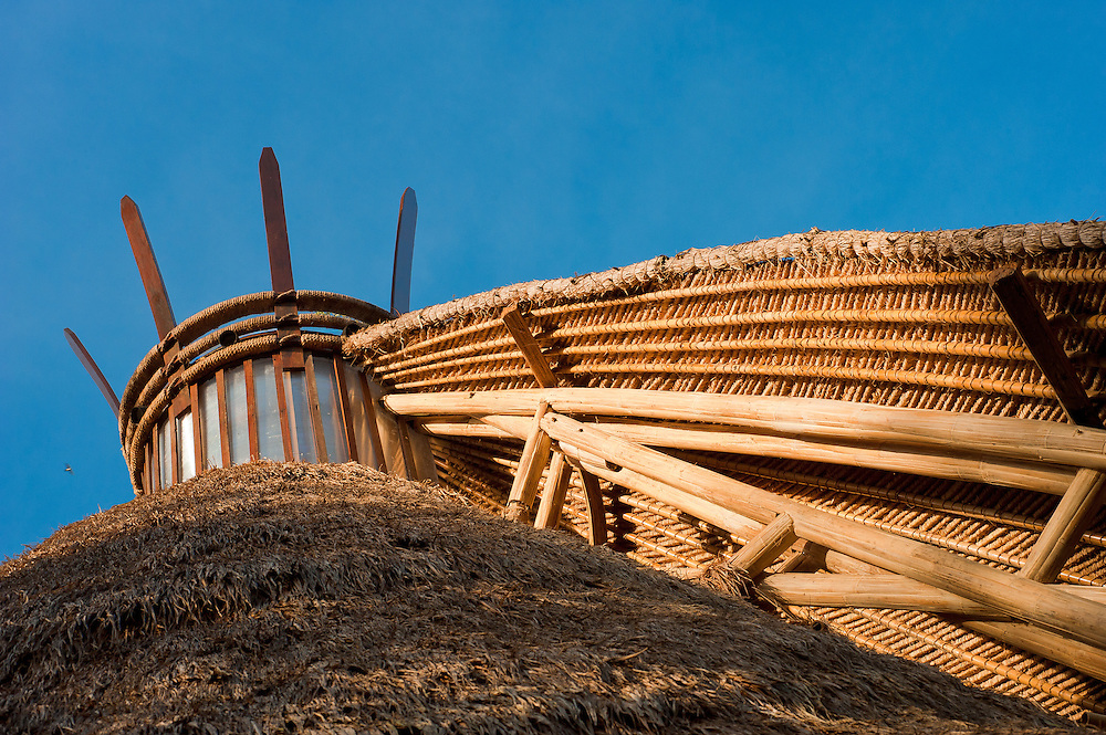 Each mandala building is topped by a skylight and crown. Giant bamboo provides the principal support.