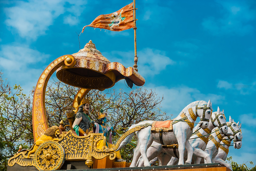 Statue of Lord Krishna riding in a chariot, Holi (festival of colors), Mathura, Uttar Pradesh, India.