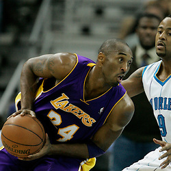12 November 2008: Los Angeles Lakers guard Kobe Bryant (24) dives past New Orleans Hornets guard Morris Peterson (9) during a 93-86 win by the Los Angeles Lakers over the New Orleans Hornets at at the New Orleans Arena in New Orleans, LA..