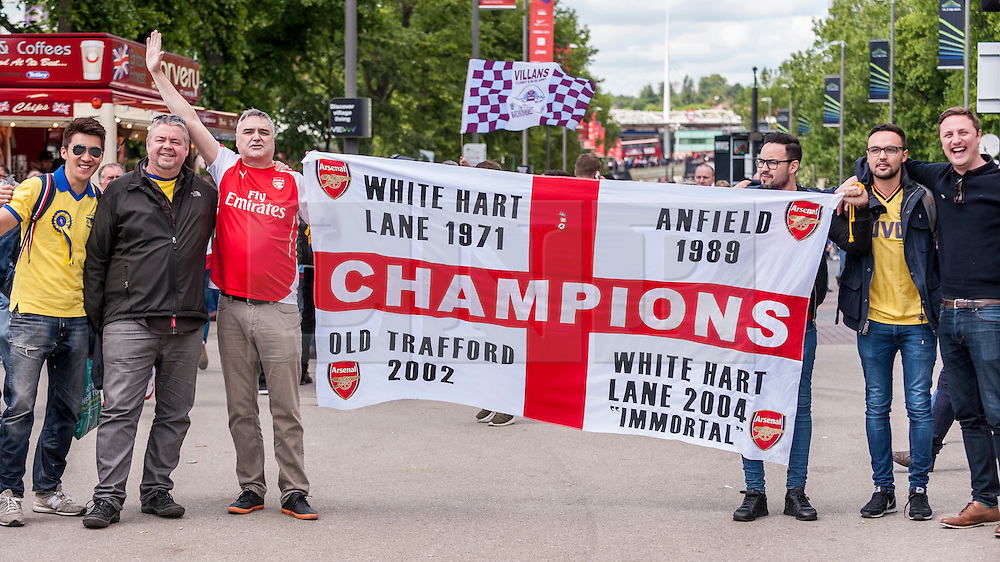© Licensed to London News Pictures. 30/05/2015. London, UK. Arsenal fans wave a flag, as fans gather at Wembley Stadium for the FA Cup Final 2015, between Arsenal and Aston Villa. Photo credit : Stephen Chung/LNP