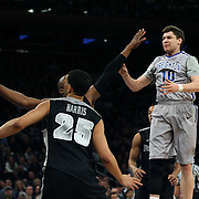 Grant Gibbs, (right), Creighton, in action during the Creighton Bluejays Vs Providence Friars basketball game during the Big East Conference Tournament Final at Madison Square Garden, New York, USA. 15th March 2014. Photo Tim Clayton