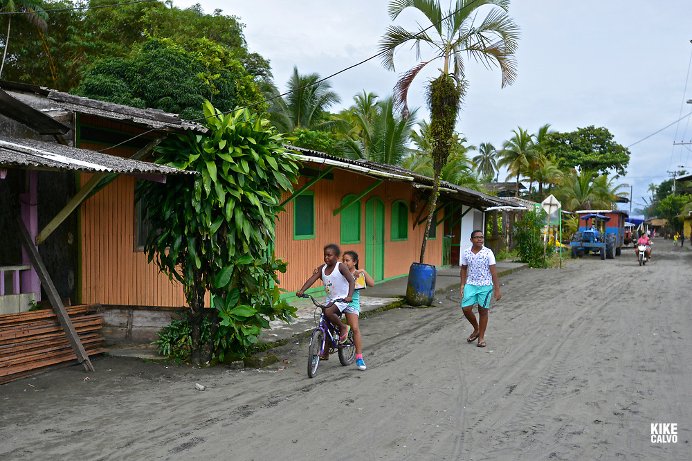 Children play in from of their simple home in Juanchaco, Colombian Pacific Coast