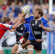 20,05/06 Powergen Cup Bath Rugby vs Bristol Rugby,  Andy Beattie looks to pass the ball as he's tackled by the Bristol defenders. Bath, ENGLAND, 01.10.2005   © Peter Spurrier/Intersport Images - email images@intersport-images..