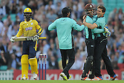 Surrey All-Rounder Zafar Ansari and Surrey Wicket-Keeper Ben Foakes celebrate the wicket of Hampshire T20 all-rounder Darren Sammy during the NatWest T20 Blast South Group match between Surrey County Cricket Club and Hampshire County Cricket Club at the Kia Oval, Kennington, United Kingdom on 9 June 2016. Photo by David Vokes.