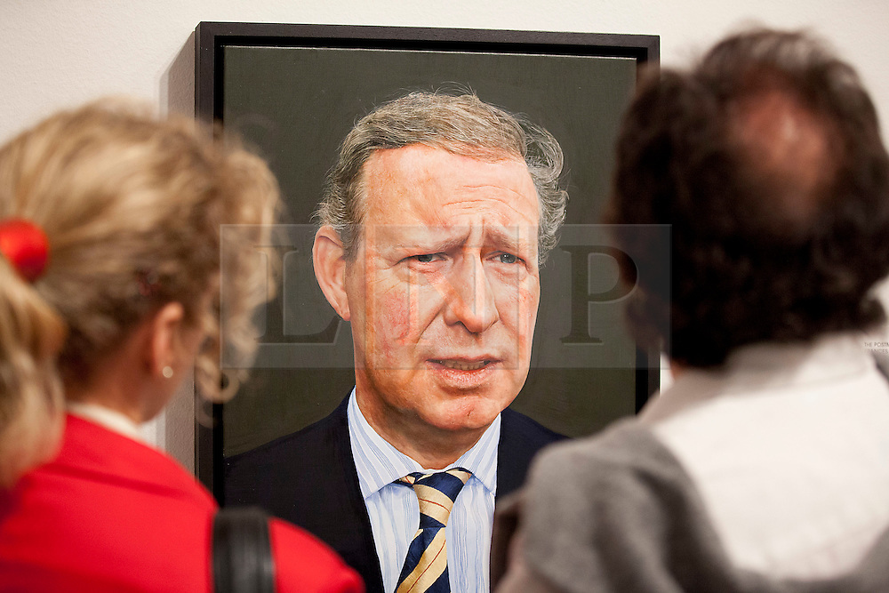 © Licensed to London News Pictures. 20/06/2012. LONDON, UK. Two art fans view Edward Sutcliffe's 'Trying to be Something Else' at an exhibition of selected works entered into the 2012 BP Portrait Award at the National Portrait Gallery in London today (20/06/12). The annual British Petroleum sponsored event runs from the 21st of June to the 23rd of September and highlights the work of portrait artists working in a variety of styles and techniques . Photo credit: Matt Cetti-Roberts/LNP