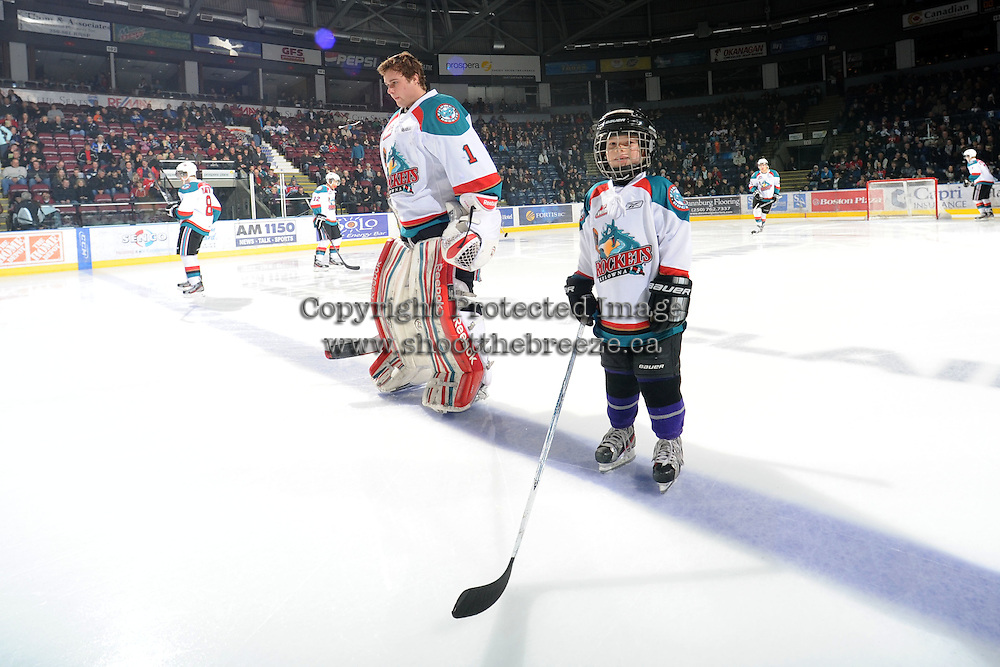 KELOWNA, CANADA, FEBRUARY 17: The Pepsi Save On Foods player of the game lines up next to Adam Brown #1 of the Kelowna Rockets against the Calgary Hitmen at the Kelowna Rockets on February 17, 2012 at Prospera Place in Kelowna, British Columbia, Canada (Photo by Marissa Baecker/Shoot the Breeze) *** Local Caption ***
