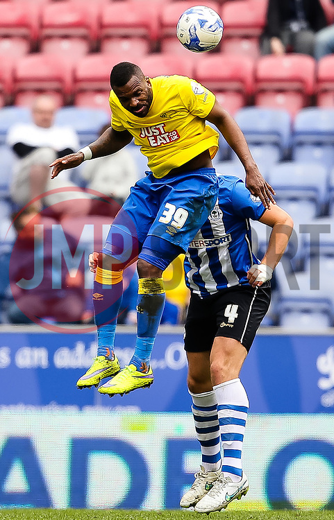 Darren Bent of Derby County wins a header against Harry Maguire of Wigan Athletic  - Photo mandatory by-line: Matt McNulty/JMP - Mobile: 07966 386802 - 06/04/2015 - SPORT - Football - Wigan - DW Stadium - Wigan Athletic v Derby County - SkyBet Championship