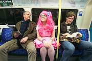 UNITED KINGDOM, London: 25 October 2014. <br /> Comic Con Feature.<br /> A Cosplay fan (Simmi Chopra, 15) sits on the London underground as she makes her way to the ExCel Centre for the biannual MCM Comic Con.<br /> Photo: Rick Findler / Story Picture Agency