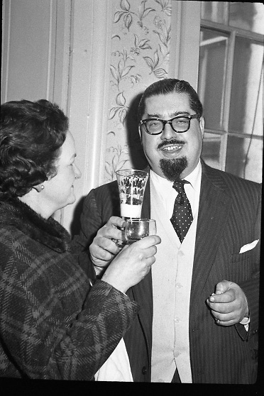 Dr Paul Singer and his wife Irma drink to each others health after his acquittal by the Criminal Court. He had previously been tried for fraud and sentenced to 14 years in connection with the Shanahans stamps affair..24.01.1962