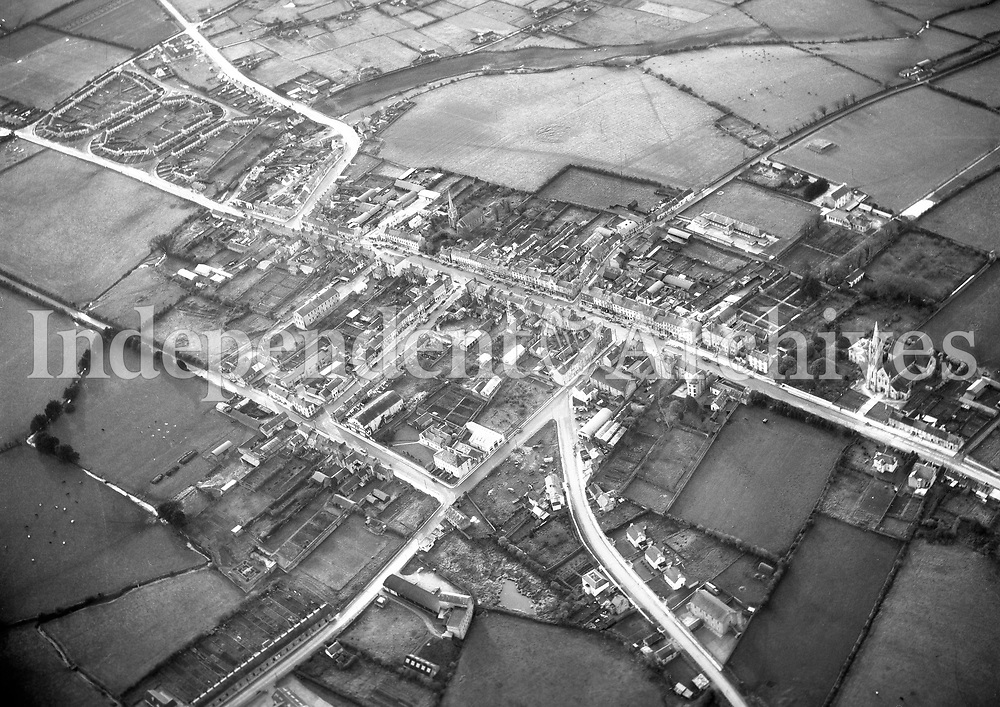 A346 Rathlurc (Rathluirc) Charleville.   28/02/58 (Part of the Independent Newspapers Ireland/NLI collection.)<br /> <br /> These aerial views of Ireland from the Morgan Collection were taken during the mid-1950's, comprising medium and low altitude black-and-white birds-eye views of places and events, many of which were commissioned by clients. From 1951 to 1958 a different aerial picture was published each Friday in the Irish Independent in a series called, 'Views from the Air'.The photographer was Alexander 'Monkey' Campbell Morgan (1919-1958). Born in London and part of the Royal Artillery Air Corps, on leaving the army he started Aerophotos in Ireland. He was killed when, on business, his plane crashed flying from Shannon.