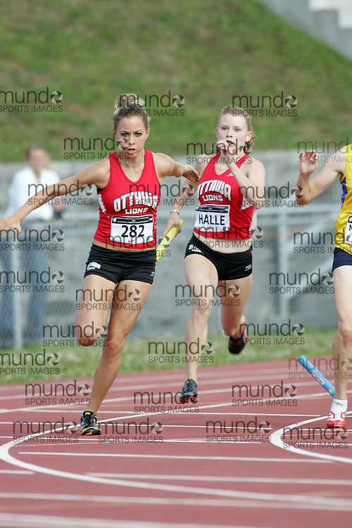 (Sherbrooke, Canada---23 July 2006) Emilie Halle to Catherine Lalonde in the 4x100m relay at  the 2006 Canadian Junior Track and Field Championships and national multi-events championships 21-23 July 2006 held in Sherbrooke Quebec. Copyright 2006 Sean Burges / Mundo Sport Images, www.mundosportimages.com