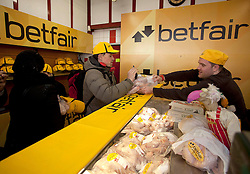 Repro Free: Andrew Carroll pictured as as Betfair gave away 150 free turkeys to members of the public as part of their ?Beat the Budget? campaign. Pic Andres Poveda.