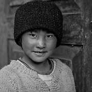 Portrait of a Bhutanese boy at the door of the RSPN (Royal Society for the Protection of Nature) Crane Observatory ,Phobjikha Valley, Gangtey, Bhutan, Asia