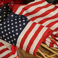 A stack of American flags wait to be used by Lawhon Elementary third grade students in their veterans day program that will be preformed Thursday at 10:45, 12:45 and 6 p.m. at the schools auditorium.