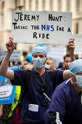 **Junior doctors in England have today (19/11/2015) voted in favour of strike action in a dispute over Government's proposed changes to work and pay contracts** FILE PICTURE © London News Pictures. 17/10/2015. London, UK.  Thousands of Doctors take part in a demonstration in Westminster, central London in support of junior Doctors over changes to NHS contracts.  Photo credit: Ben Cawthra/LNP