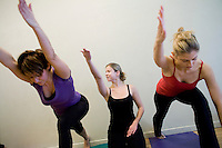 26 November, 2008. New York, NY. Chrissy Carter, 30, teaches some yoga poses to her students at the Yogaworks in Manhattan, NY, where she is a yoga instructor. She's a former college dancer and Wall Steret equity sales trader. She quit her job after falling in love with yoga. She started teaching 6 years ago and started teaching full-time 4 years ago. She now also certifies yoga teachers.<br /> <br /> ©2008 Gianni Cipriano for The New York Times<br /> cell. +1 646 465 2168 (USA)<br /> cell. +1 328 567 7923 (Italy)<br /> gianni@giannicipriano.com<br /> www.giannicipriano.com
