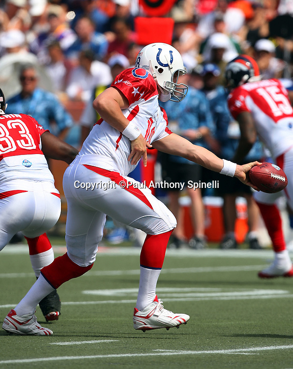 HONOLULU, HI - FEBRUARY 08: AFC All-Stars quarterback Peyton Manning #18 of the Indianapolis Colts hands off the ball on a running play against the NFC All-Stars in the 2009 NFL Pro Bowl at Aloha Stadium on February 8, 2009 in Honolulu, Hawaii. The NFC defeated the AFC 30-21. ©Paul Anthony Spinelli *** Local Caption *** Peyton Manning