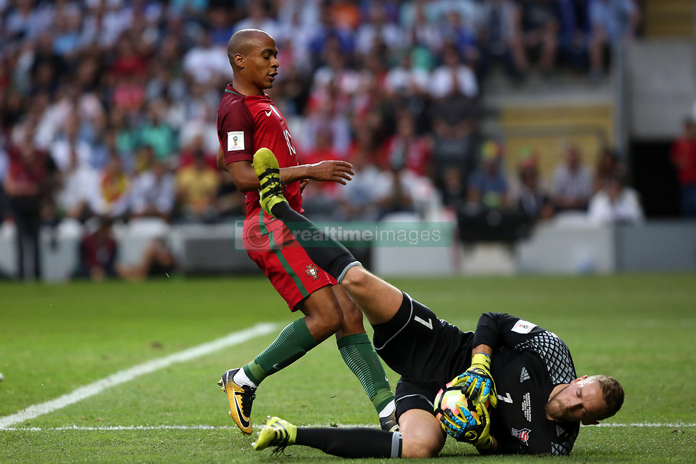 August 31, 2017 - Porto, Portugal - Portugal's midfielder Joao Mario (L) vies with Faroe Islands' goalkeeper Gunnar Nielsen during the 2018 FIFA World Cup qualifying football match between Portugal and Faroe Islands at the Bessa XXI stadium in Porto, Portugal on August 31, 2017. (Credit Image: © Pedro Fiuza/NurPhoto via ZUMA Press)