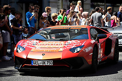 © Licensed to London News Pictures. 05/08/2018. LONDON, UK. A Lamborghini sets off from the start.  Gumball 3000, a charity rally for supercars and more, including celebrity entrants, begins in Covent Garden with 150 participants beginning their journey from London to Tokyo.  Photo credit: Stephen Chung/LNP