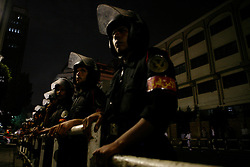Egyptian police stand guard outside a protest at the Press Syndicate building in downtown Cairo.