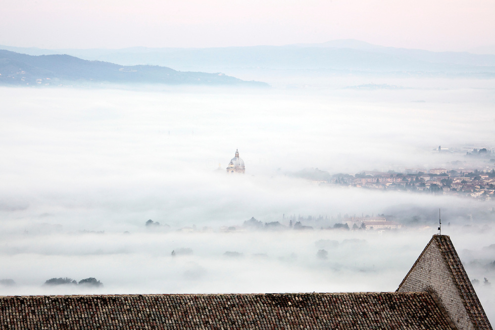 Assisi valley, Italy, with view on dome Basilica of Santa Maria degli Angeli