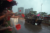 HONG KONG- JULY 1: With a cheering crowd of people in Hong Kong, the Chinese military drive over the border in the early morning hours of July 1, 1997 in Hong Kong, China. On July 1, 1997 Hong Kong was handed over to China from the United Kingdom after being a colony for 150 years. (Photo by David Paul Morris) ..