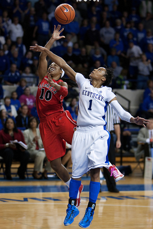 UK guard A'dia Mathies, right, contests a shot by Georgia guard Jasmine James in the second half. Georgia defeated UK, 75-71 breaking the Wildcats 34 home game winning streak. The University of Kentucky Women's Basketball team hosted Georgia, Sunday, Feb. 03, 2013 at Memorial Coliseum in Lexington.