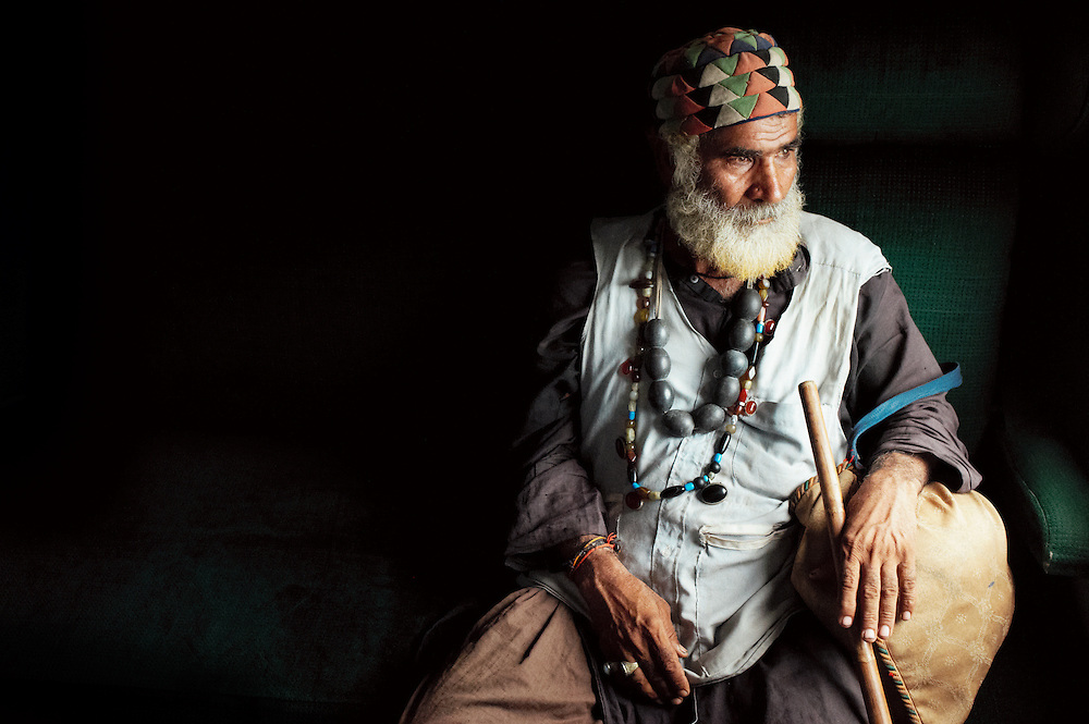 Sufi Beggar Joman, 80 years oldsits on the Khyber Mail traveling from Rawalpindi to Karachi on August 13, 2011. He is from Nowabshah, Sindh Province. He has two wives and twelve children. He has been a beggar for life.