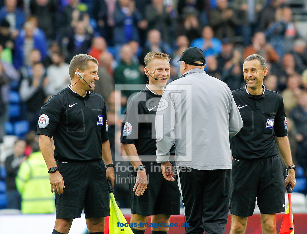 Russell Slade, Manager of Cardiff City congratulated by Officials after the Sky Bet Championship match at the Cardiff City Stadium, Cardiff<br /> Picture by Mike  Griffiths/Focus Images Ltd +44 7766 223933<br /> 18/10/2014