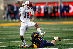 BERKELEY, CA - DECEMBER 01: Cornerback Paulson Adebo #11 of the Stanford Cardinal intercepts a pass intended for wide receiver Vic Wharton III #17 of the California Golden Bears during the fourth quarter at California Memorial Stadium on December 1, 2018 in Berkeley, California. The Stanford Cardinal defeated the California Golden Bears 23-13. (Photo by Jason O. Watson/Getty Images) *** Local Caption *** Paulson Adebo; Vic Wharton III