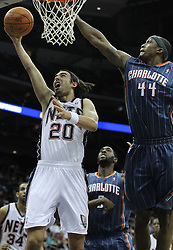 Apr 11; Newark, NJ, USA; New Jersey Nets shooting guard Sasha Vujacic (20) has a shot blocked by Charlotte Bobcats forward Dante Cunningham (44) during the first half at the Prudential Center.