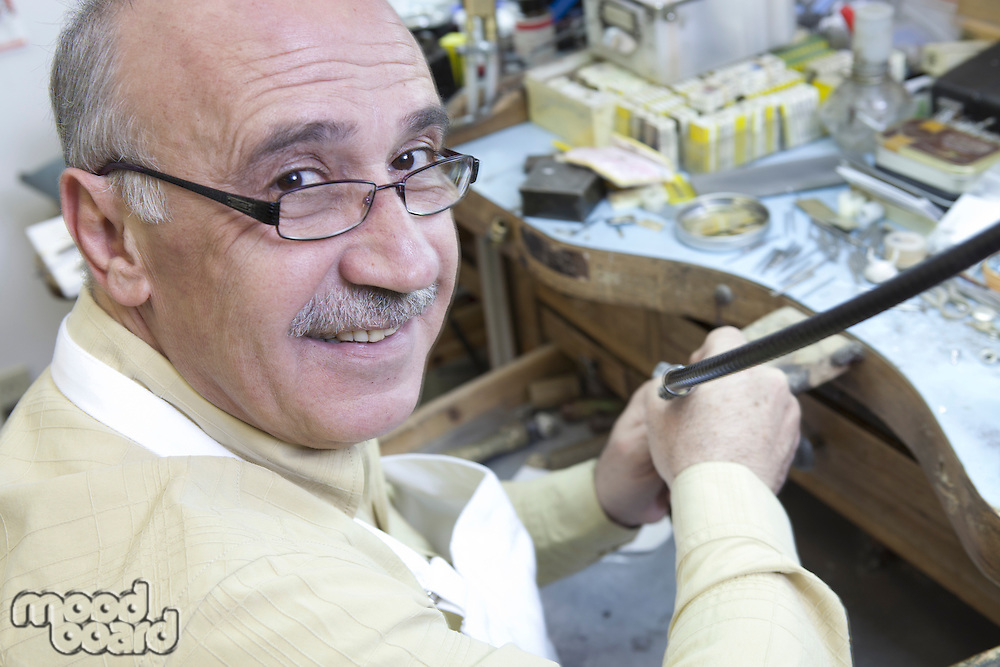 Portrait of a mature skilled worker in repair workshop