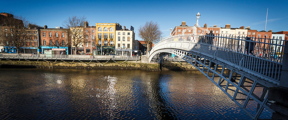 2012: Dublin, Ireland. A panoramic shot of the famous Ha'Penny bridge in Dublin and the River Liffey