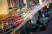 SHOT 3/17/2007 - Images of the holiday lights strung up over Larimer Square in downtown Denver, Co. What began as Denver's very first city block is now one of the city's hottest shopping, dining and nightlife districts. Larimer Square has become the hottest restaurant neighborhood in town, thanks to an aggressive effort to bring regionally exclusive, chef-driven restaurants to the block. Every year the block strings lights across the street to celebrate the holiday season..(Photo by Marc Piscotty © 2007)