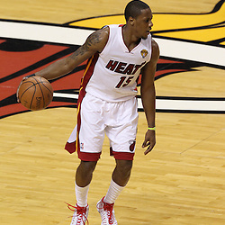 Jun 21, 2012; Miami, FL, USA; Miami Heat point guard Mario Chalmers (15) brings the ball up the court against the Oklahoma City Thunder during the first quarter in game five in the 2012 NBA Finals at the American Airlines Arena. Mandatory Credit: Derick E. Hingle-US PRESSWIRE