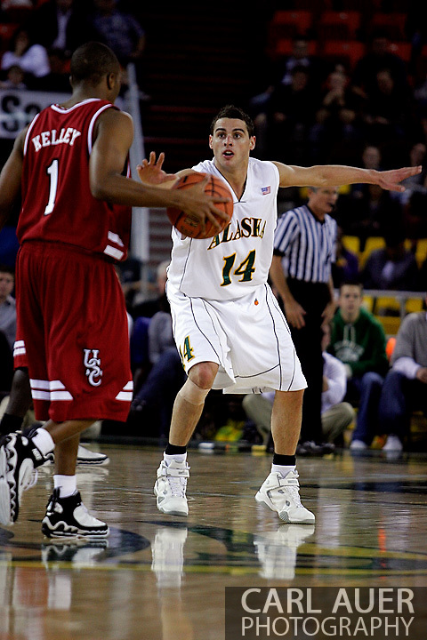 24 November 2005:  University of Alaska Anchorage sophomore guard Luke Cooper (14) out of Eltham, Australia,  sets up the defense against Tre Kelly brings the ball down the court for the Gamecock's in the first half of the UAA Seawolves 60-65 loss to the South Carolina Gamecock's in the first round of the Great Alaska Shootout at the Sullivan Arena in Anchorage Alaska.