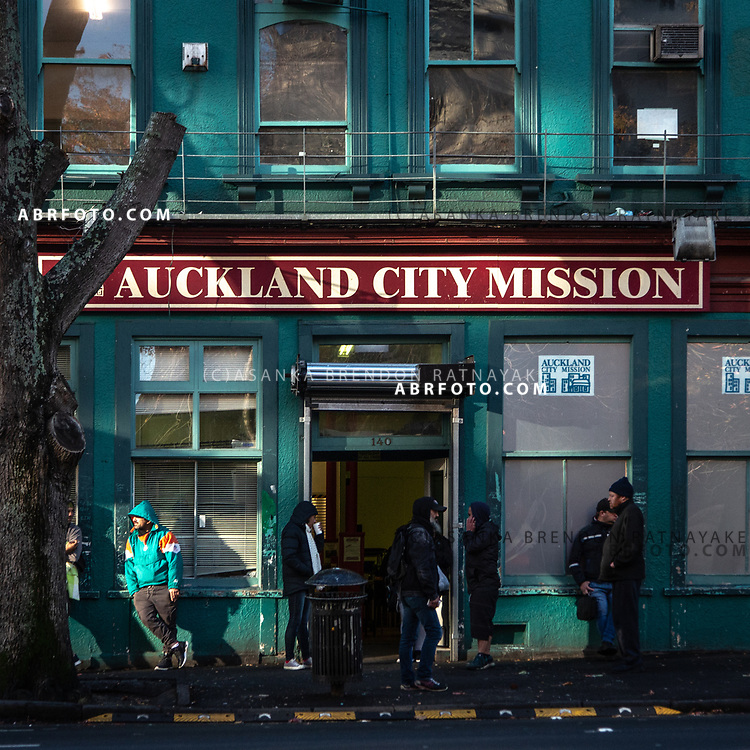 People outside the front of the Auckland City Mission on the 7th of June 2018. The Auckland City Mission provides a number of social services for the homeless, it also offers free food for the homeless. Asanka Brendon Ratnayake for The New York Times.
