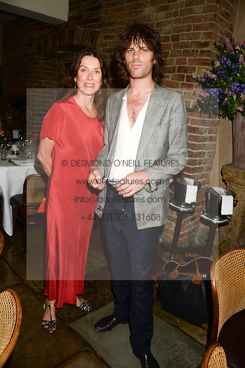 CHARLOTTE SCOTT and her son JACKSON SCOTT at an evening of Dinner & Dancing at Daphne's, 112 Draycott Avenue, London SW3 on 24th July 2013.